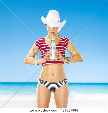 Healthy Woman On Seacoast Drinking Cocktail