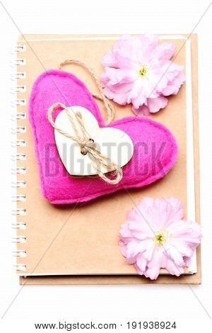 Heart In Pink Colour And Pink Sakura Flowers On Notebook