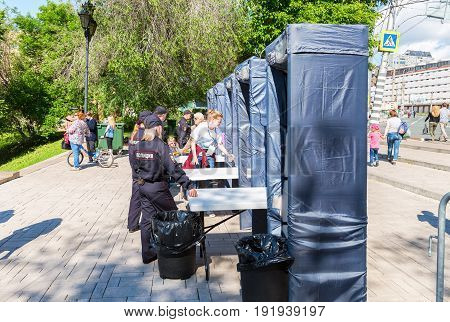 Samara Russia - May 12 2017: Fence with police frames metal detectors at the city street in summer sunny day