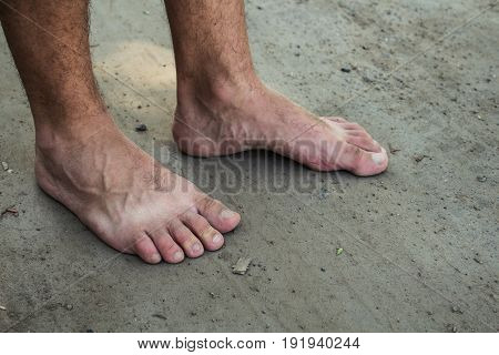 feet of a man on the ground summer