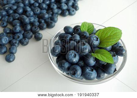 Blueberries fruit bowl healthy fresh summer antioxidant background.