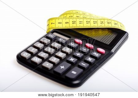 Concept of weight management counting and metering: yellow flexible ruler and calculator isolated on white background