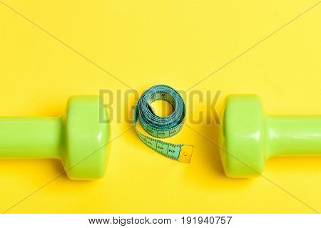 Dumbbells With Cyan Measuring Tape In Roll