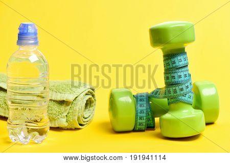 Water Bottle, Green Lightweight Dumbbells, Cyan Blue Measuring Tape