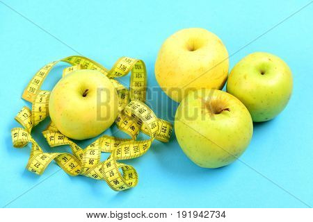 Tape For Measuring Or Flexible Ruler And Green Apples