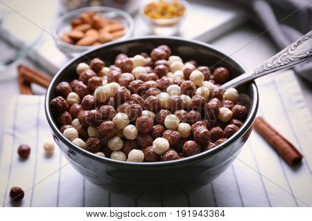 Bowl with delicious cereal balls on table