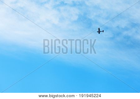 One lightweight monoplane against the blue sky