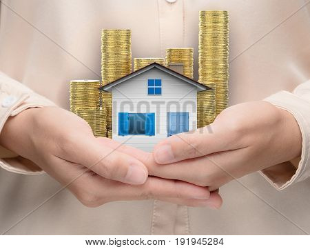 ownership concept with hand holding house model
