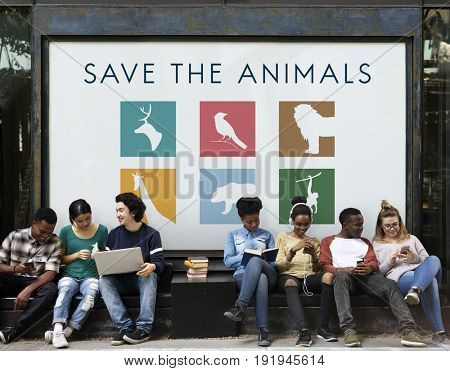 Diverse group of young people with save animals banner