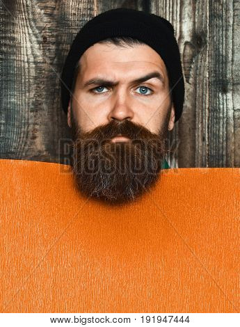 Bearded Brutal Caucasian Hipster With Orange Paper Sheet