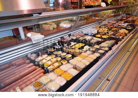 Showcase with different food in supermarket
