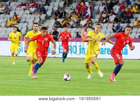 CLUJ-NAPOCA, ROMANIA - 13 JUNE 2017: Chile's Alexis Sanchez (L) vies for the ball with Vlad Chiriches (R) of Romania during the Romania vs Chile friendly, Cluj-Napoca, Romania - 13 June 2017