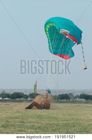 Skydiver Making A Hard Landing With Open Parachute.