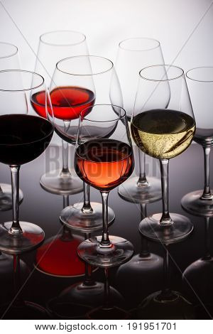 Set of glasses with red, white and rose wine close up