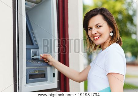 Young Beautiful Woman Using An Atm