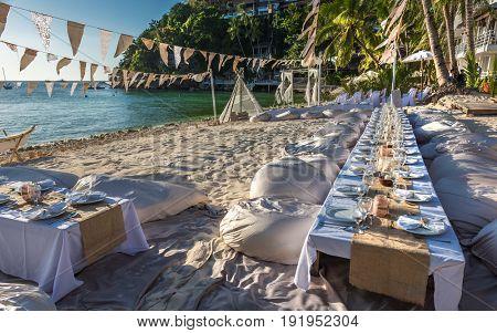 decorated wedding tables on Diniwid Beach at Boracay island Philippines