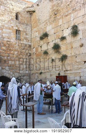 JERUSALEM, ISRAEL - June 15, 2017: religious jews, praying at the Wailing Wall ( Western Wall or Kotel ), Old City of Jerusalem, Israel