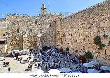 JERUSALEM, ISRAEL - June 15, 2017: religious jews, praying at the Wailing Wall ( Western Wall or Kotel ), Old City of Jerusalem, Israel