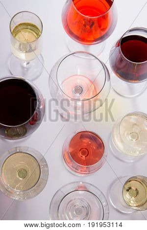Set of glasses with red, white and rose wine, top view