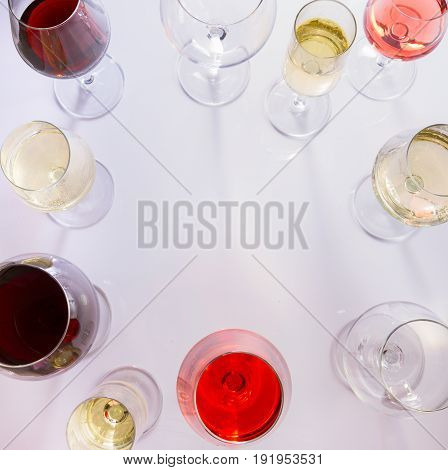 Set of glasses with red, white and rose wine, top view frame with copy space