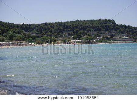 Halkidiki, Greece - June 10 2017: Sani luxury hotel resort view. Day view of hotel complex beach at Sani resort in Kassandra Chalkidiki peninsula.