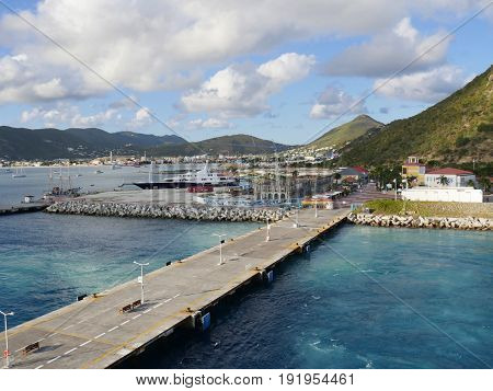 Concrete pier of St. Martin, Caribbean A long concrete pier extends into the blue waters to accommodate cruise ships at Philipsburg, St. Martin in the Caribbean.