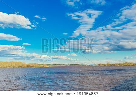 Spring flood on the river Vyatka on a cloudy day
