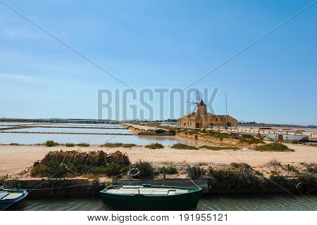 Salt Mills Are Seen In Suburbs Of Marsala, Sicily, Italy.