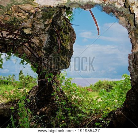 Japanese pillbox holes, Saipan Huge holes from an old Japanese pillbox in San Antonio, near Coral Ocean Point serve as outlet for cannons during the World War 11 in Saipan, Northern Mariana Islands