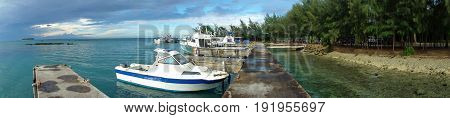 A panoramic view of the Smiling Cove Marina with yachts and boats moored at the docks, Saipan, Northern Mariana Islands
