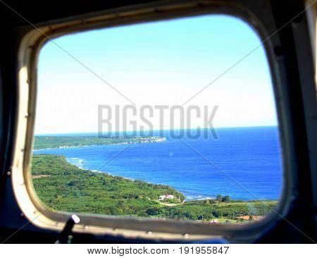 Window View, Saipan coastal Coastal view of the southern part of Saipan, Northern Mariana Islands seen from an airplane window