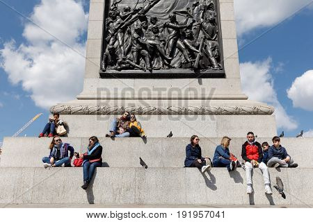 Adults And Children Rest At The Base Of The Nelson Column