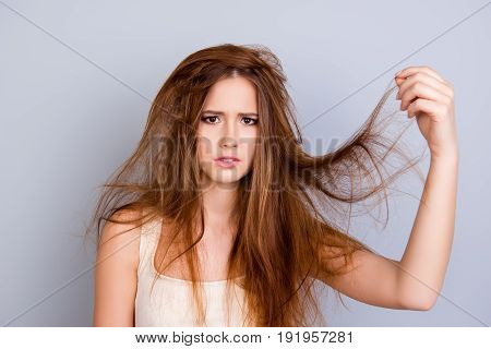 Close Up Portrait Of Frustrated Young Girl With Messed Hair On Pure  Background, Wearing White Casua