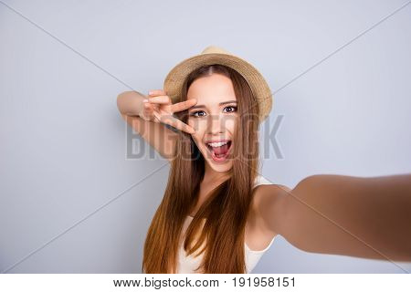 Summer, Sunny, Funky, Playful Mood. Cute Young Very Cheerful Girl Is Making Selfie On A Camera Of He