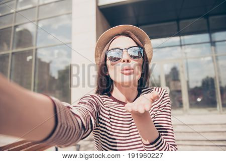 Selfie Time! Air Kiss For You! Cute Young Lady Is Making Selfie On A Camera. She Is Wearing Casual S