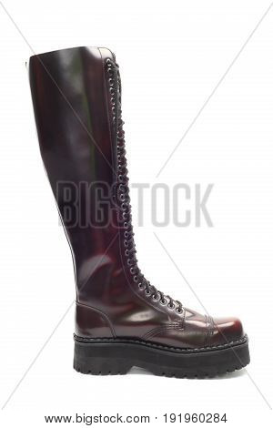 Single leather high boot isolated over white