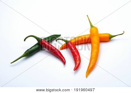 Multiple color red green yellow chilli pepper isolated on white background