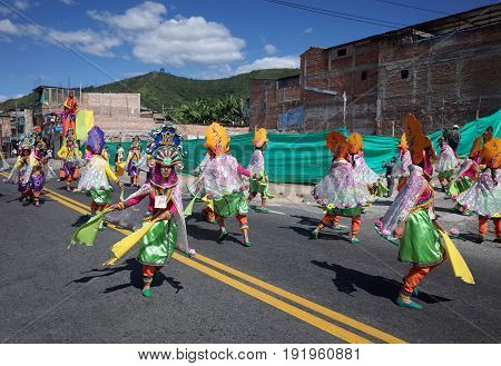 5TH JANUARY 2015 CHICHAGUÍ COLOMBIA - dancers in traditional indigenous clothes take part in the celebrations at the Carnival de Blancos y Negros (Blacks and White Carnival) in Chichaguí near Pasto in Colombia