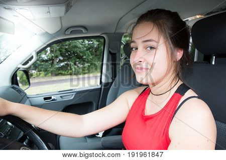 Driver Girl In Van Or Car Smiling And Happy