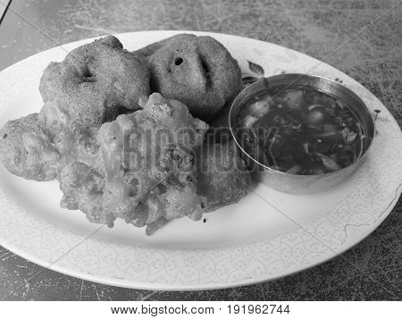 BLACK AND WHITE PHOTO OF TEMPURA: VEGETABLES COVERED IN BATTER AND FRIED