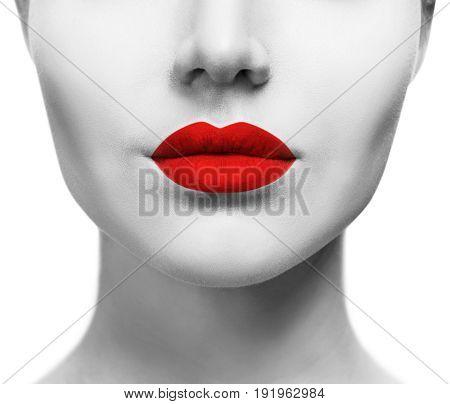 Beautiful sexual red lips closeup. Sensual mouth of young woman.