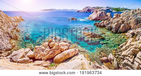 Pure clear azure sea water and amazing rocks on coast of Maddalena island, Sardinia, Italy.