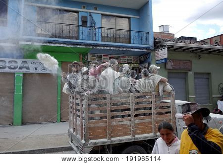 6TH JANUARY 2015 PASTO COLOMBIA - a man throws white powder out of a truck celebrating at the Carnival de Blancos y Negros (Blacks and White Carnival) in Pasto in Colombia