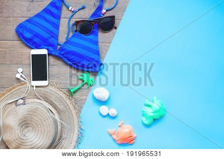 Creative flat lay style of woman summer set with smartphone Summer vacation concept