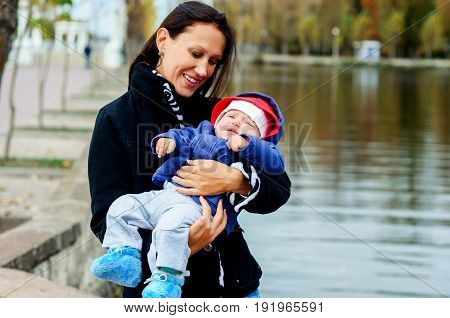 Beautiful Young Age She And Her Adorable Little Son In The Autum