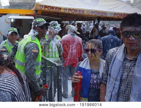 6TH JANUARY 2015 PASTO COLOMBIA - policemen join in the celebrations at the Carnival de Blancos y Negros (Blacks and White Carnival) in Pasto in Colombia