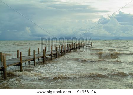 empty jetty and rough water during rainy season