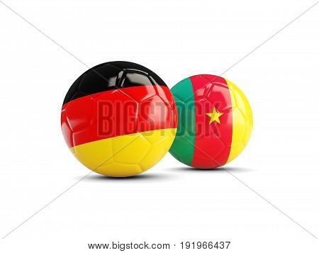Two Footballs With Flags Of Germany And Cameroon Isolated On White