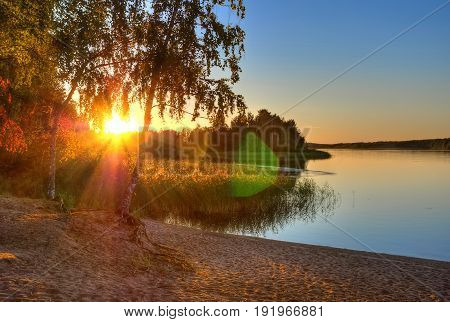 Beautiful sunset on the banks of the river Vuoksi at quiet summer evening