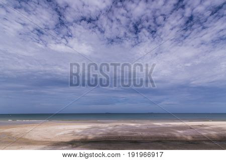The topical beach with huge cloud in the sky